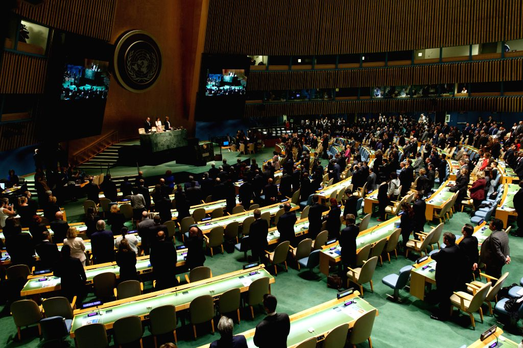 Photo taken on April 19, 2016 shows delegates observe a minute of silence during the opening ceremony of UN General Assembly high-level special session on ...