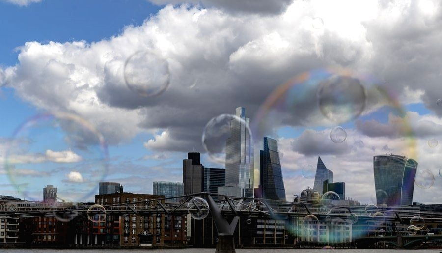 Photo taken on Aug. 1, 2020 shows a few bubbles in front of the City of London in London, Britain.