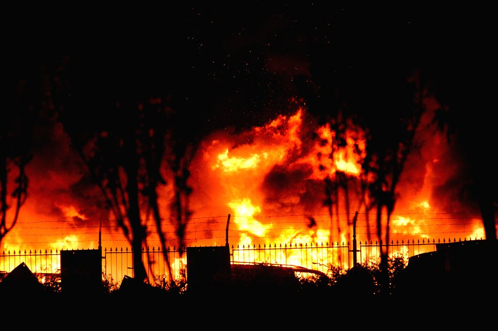 Photo taken on Aug. 13, 2015 shows the burning scene of the explosion site in the Binhai New Area in north China's Tianjin Municipality. The death toll from a ...