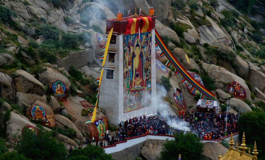 Photo taken on Aug. 14, 2015 shows the ceremony held to unfold a huge Buddha painting during the annual traditional Shoton (Yogurt) Festival at Sera Monastery in ...