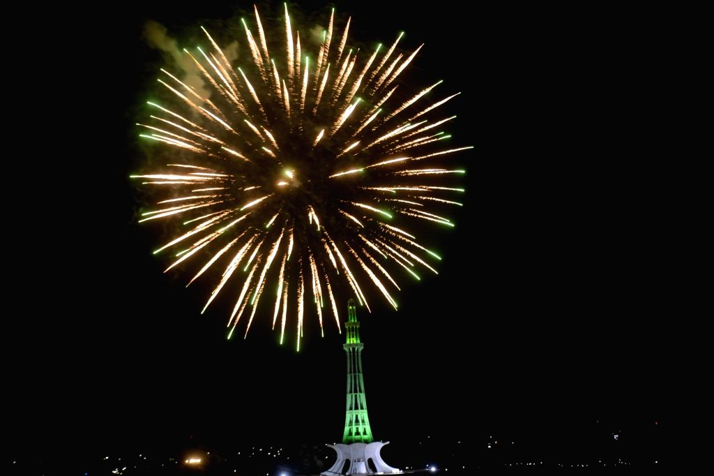 Photo taken on Aug. 14, 2020 shows fireworks at the Minar-e-Pakistan monument during Independence Day celebrations in eastern Pakistan's Lahore.   Pakistan got ...
