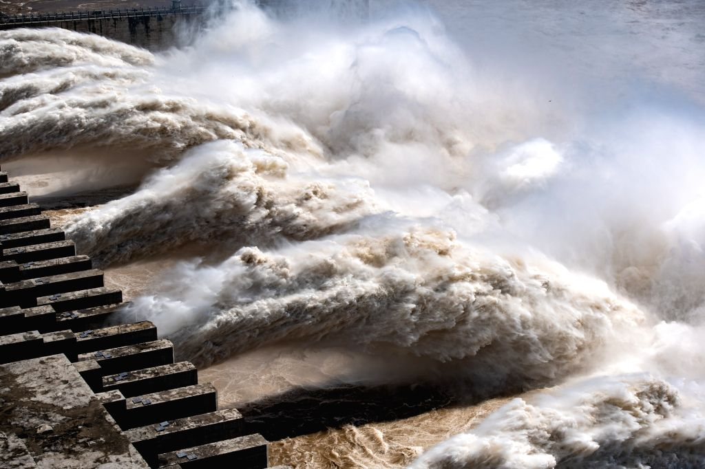 Photo taken on Aug. 14, 2020 shows water gushing out from the Three Gorges Dam in central China's Hubei Province. Yangtze River, China's longest, has recorded the ...