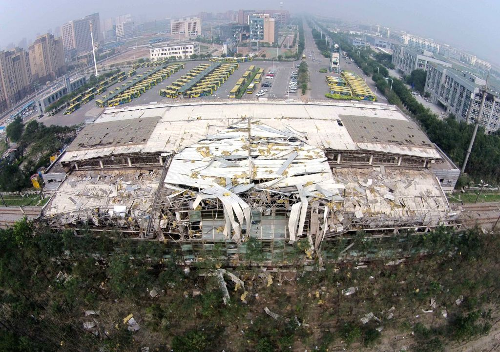 Photo taken on Aug. 15, 2015 shows a damaged building of Donghai Road Station of Jinbin Light Railine Tianjin, north China. Death toll rose to 85 as of Friday ...