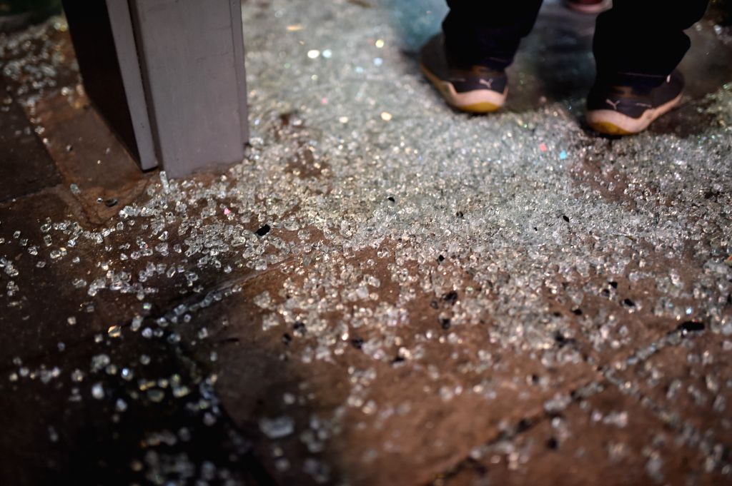 Photo taken on Aug. 17, 2015 shows debris of glass at the site of an explosion in downtown Bangkok, capital of Thailand. At least 15 people were killed and more ...