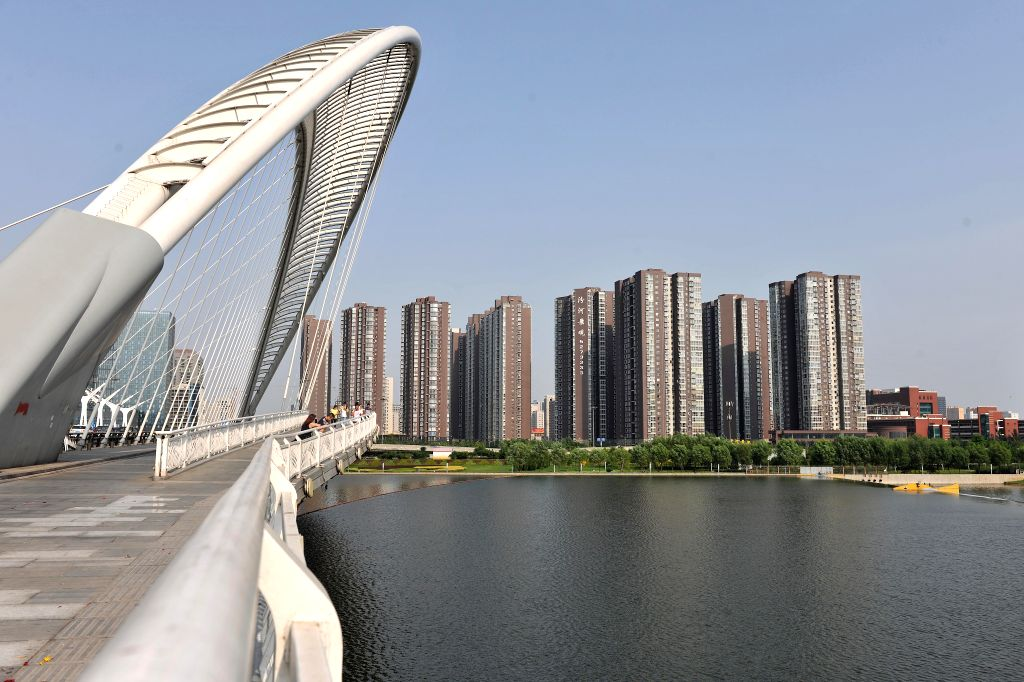 Photo taken on Aug. 17, 2015 shows residential buildings in Taiyuan, capital of north China's Shanxi Province. China's housing market continued recovering from a ...