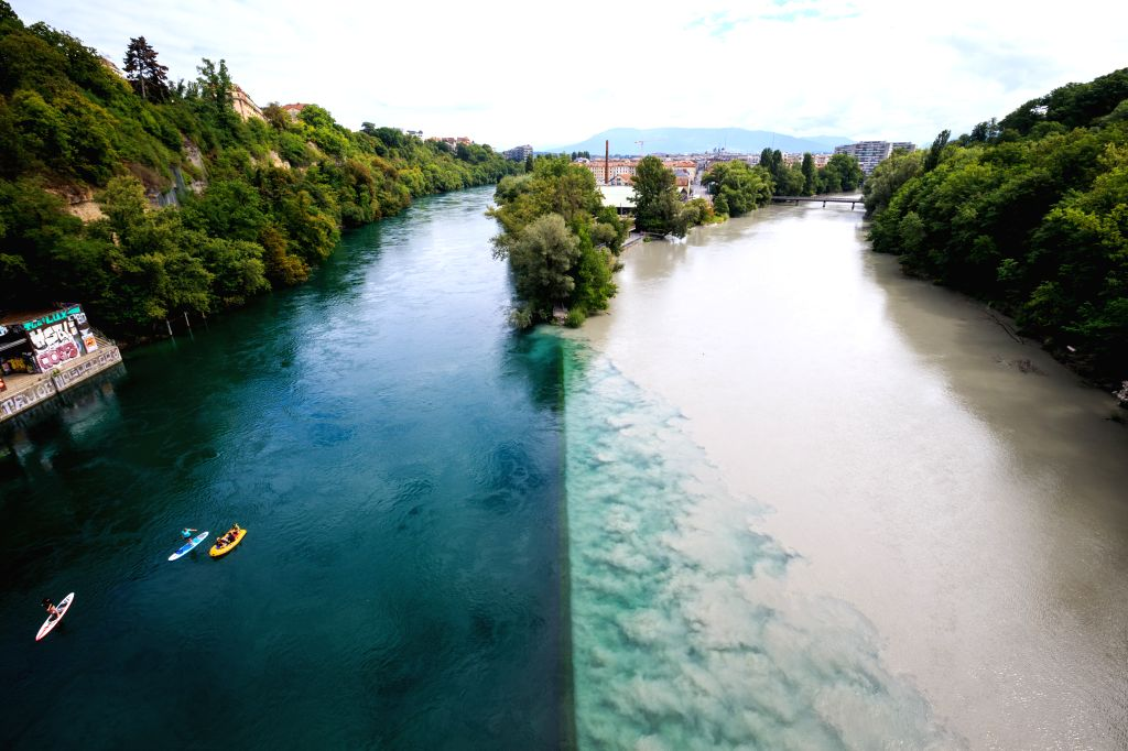Photo taken on Aug. 17, 2015 shows the junction, a place where rivers Rhone and Arve are joining each others, which creates a beautiful and unique natural ...