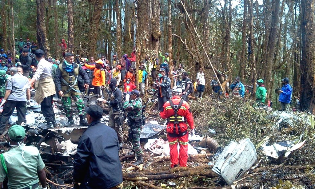 Photo taken on Aug. 18, 2015 by a local resident shows local people and members of search and rescue (SAR) team and Indonesia's National Armed Forces (TNI) ...