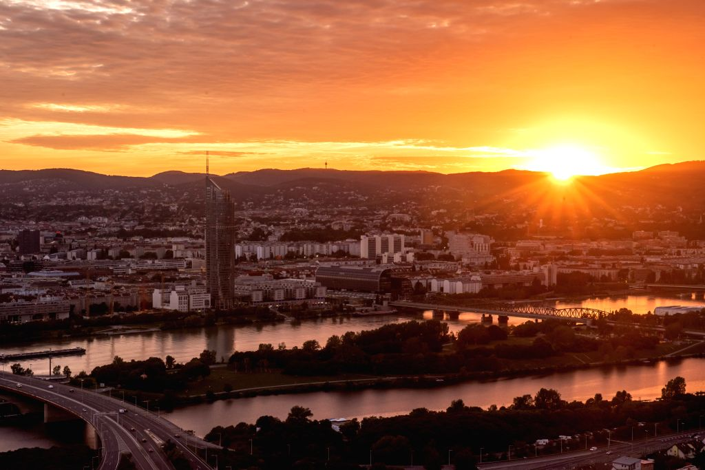 Photo taken on Aug. 27, 2020 shows the city view in sunset glow in Vienna, Austria.