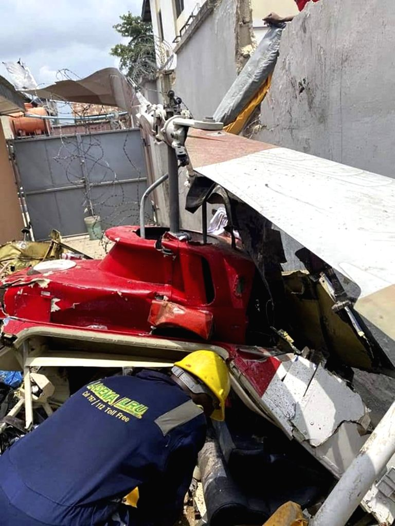 Photo taken on Aug. 28, 2020 shows the scene of a helicopter crash in Lagos, Nigeria. Two people were killed and another injured in a helicopter crash in Lagos, ...