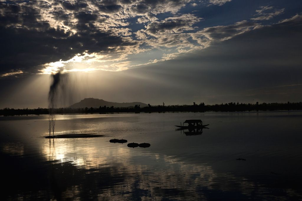 Photo taken on Aug. 29, 2020 shows a boat during sunset at Dal Lake in Srinagar, the summer capital of Indian-controlled Kashmir.