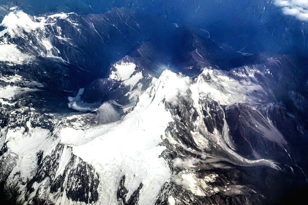 Photo taken on Aug. 3, 2015 from a flight shows the landscape of the Qinghai-Tibet Plateau, southwest China.  (Xinhua/Zheng Huansong)