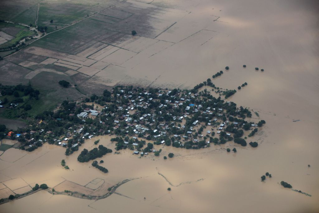 Photo taken on Aug. 3, 2015 shows an aerial view of flooded buildings in Kalay township of Sagaing Region, Myanmar. Heavy monsoon rains have left at least 47 people ...