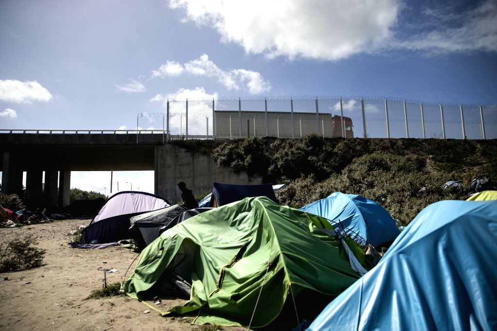 """Photo taken on Aug. 4, 2015 shows the """"The New Jungle"""" migrants camp in Calais, northern France. Calais, where the French end of the Channel Tunnel is ..."""