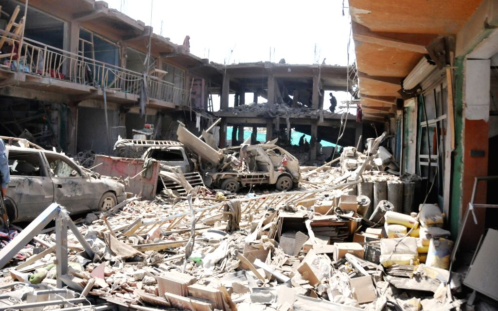 Photo taken on Aug. 7, 2015 shows a blast site in Kabul, Afghanistan. At least 8 civilians were killed and nearly 400 others wounded in a truck bomb attack in Afghan ...