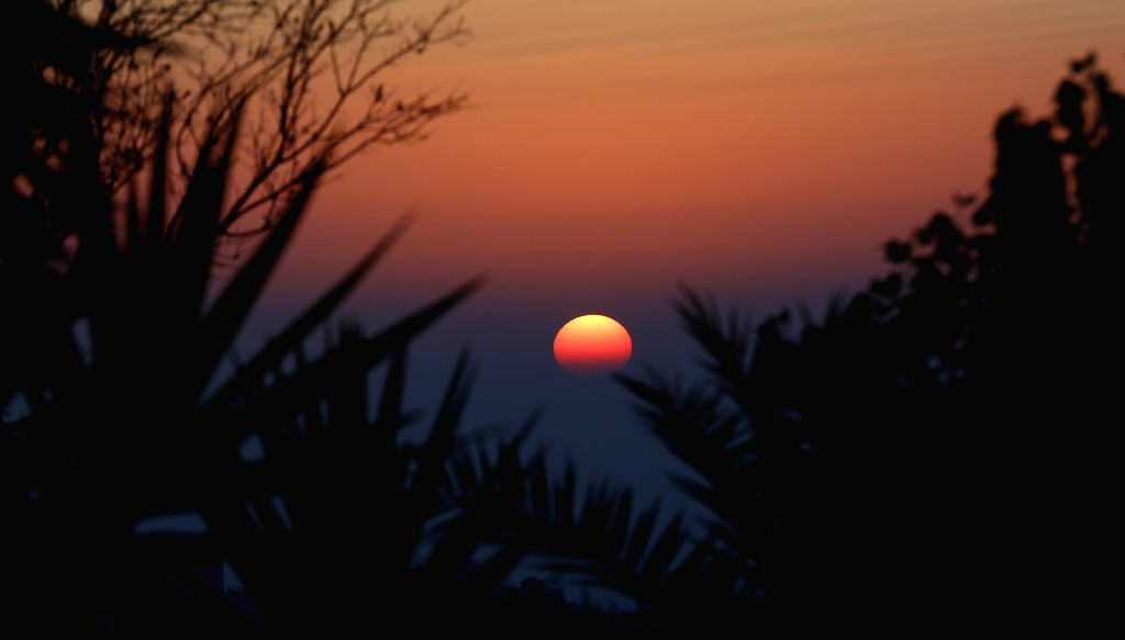 Photo taken on Aug. 7, 2020 shows the scenery of sunset in the West Bank city of Ramallah.