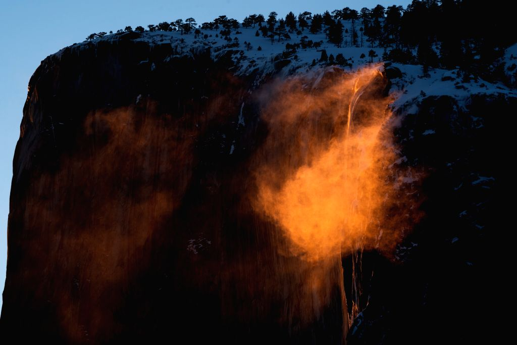 "Photo taken on Feb. 21, 2019 shows the ""firefall"" at the Yosemite National Park in California, the United States. The ""firefall"" ..."