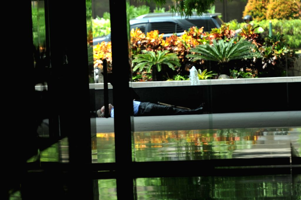 Photo taken on Jan. 14, 2015 shows a victim terrorist lying on the Thamrin street in Jakarta, Indonesia. At least six explosions were heard in the shopping mall of ...