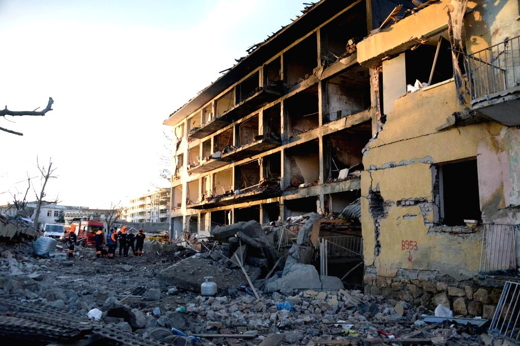 Photo taken on Jan. 14, 2016 shows the blast site in Turkey's southeastern Diyarbakir Province.Five people were killed and 39 others wounded in a car bomb attack ...