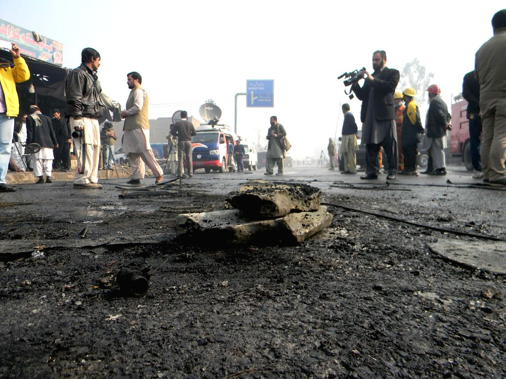 Photo taken on Jan. 19, 2016 shows a blast site in northwest Pakistan's Peshawar. At least 10 people were killed and 20 others injured on Tuesday morning in a ...