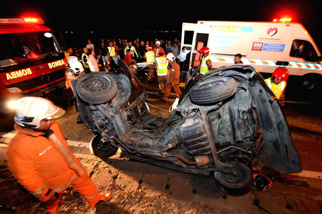 Photo taken on Jan. 19, 2016 shows the scene of a car accident in Kota Kinabalu in the state of Sabah, Malaysia. The car accident occurring in the wee hours ...