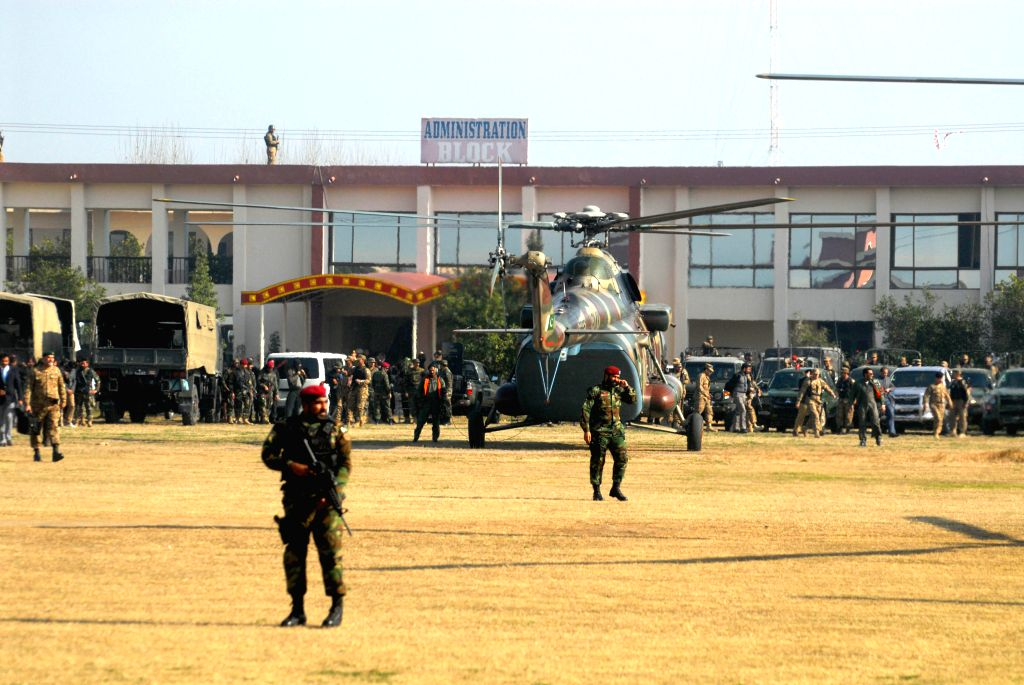 Photo taken on Jan. 20, 2016 shows an army helicopter at the Bacha Khan university following a militant attack in northwest Pakistan's Charsadda. United Nations ... - Bacha Khan