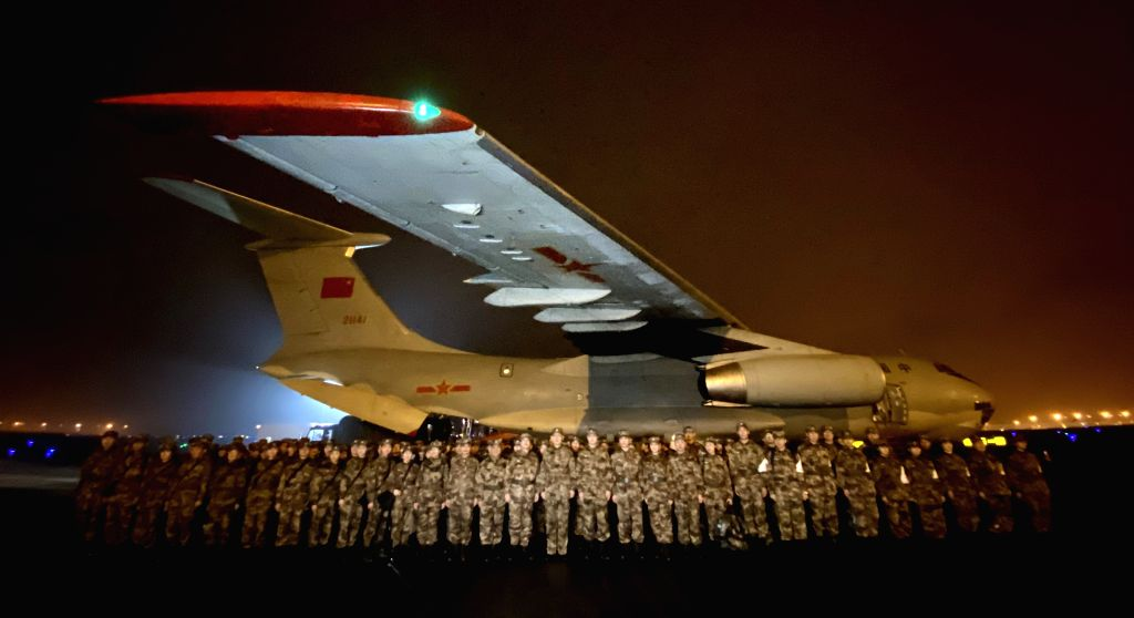 Photo taken on Jan. 24, 2020 shows a medical aid team of Army Medical University assembling before leaving for Wuhan in southwest China's Chongqing. On the ...