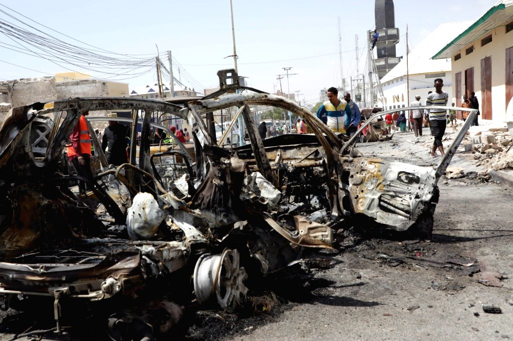 Photo taken on Jan. 8, 2020 shows the car bomb explosion site in Mogadishu, capital of Somalia. At least two people were killed and more than ten others injured ...