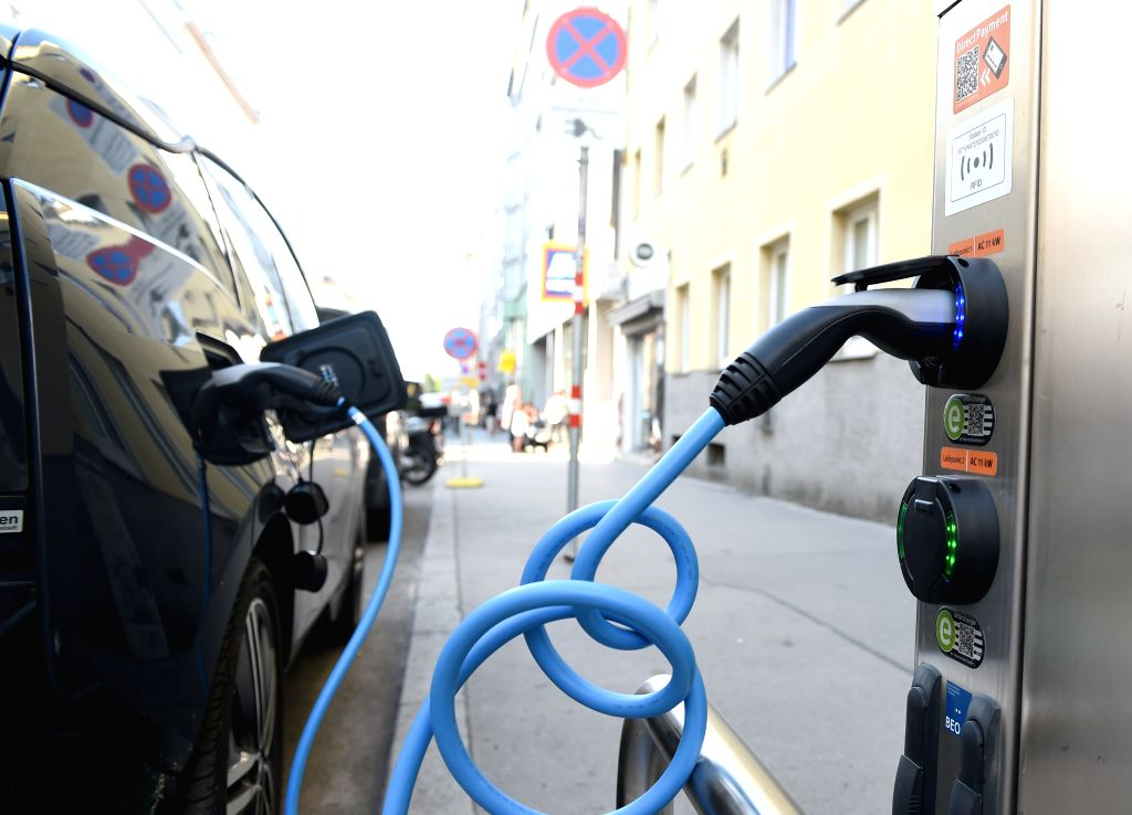 Photo taken on July 14, 2020 shows an electric car being charged at a public charging station in Vienna, Austria. According to the Austrian Federal Association for ...