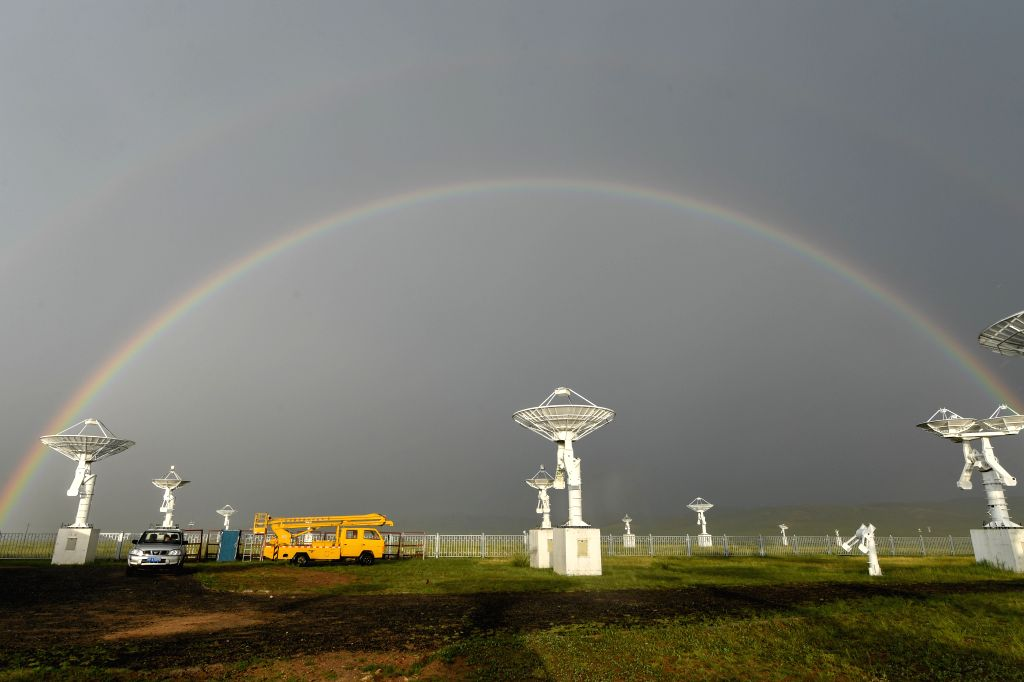 Photo taken on July 27, 2019 shows a rainbow over the Ming'antu observing station of the National Astronomical Observatories of the Chinese Academy of ...
