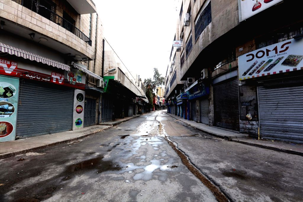 Photo taken on March 21, 2020 shows closed stores in the center of the Jordanian capital after the start of the nationwide curfew in Amman, Jordan. On March 21, ...