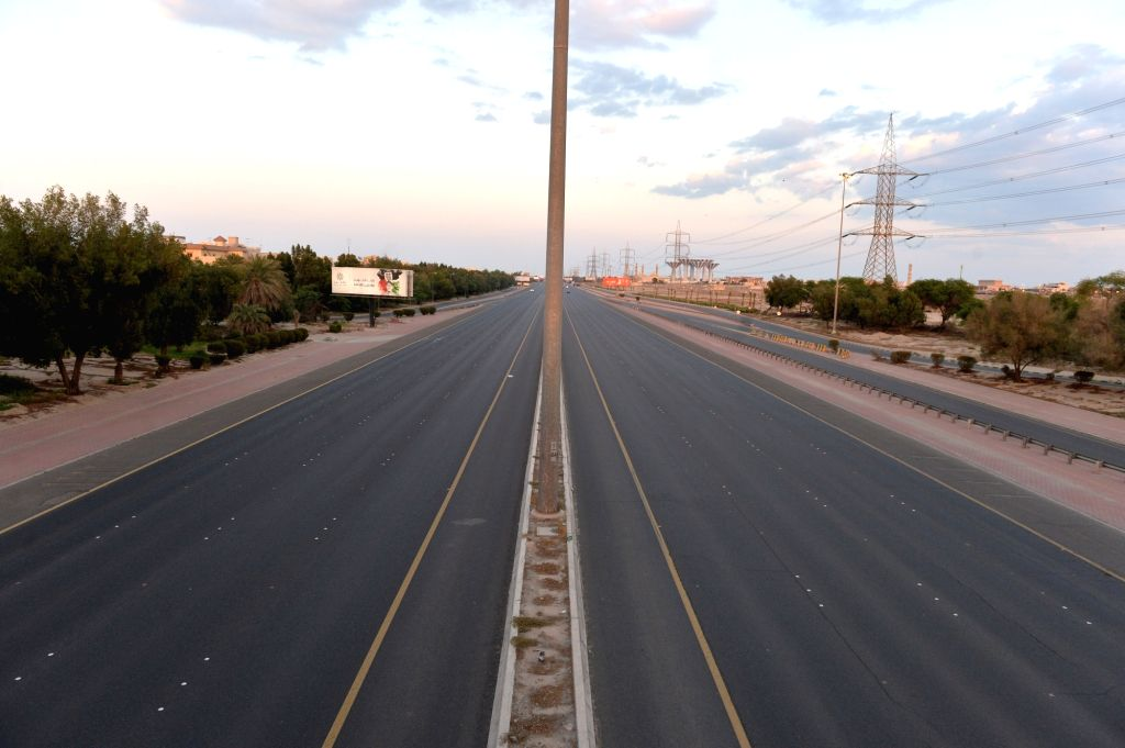 Photo taken on March 23, 2020 shows empty roads after the start of a curfew decreed by the government in Hawalli Governorate, Kuwait.   The Kuwaiti government has decided to impose a nationwide ...