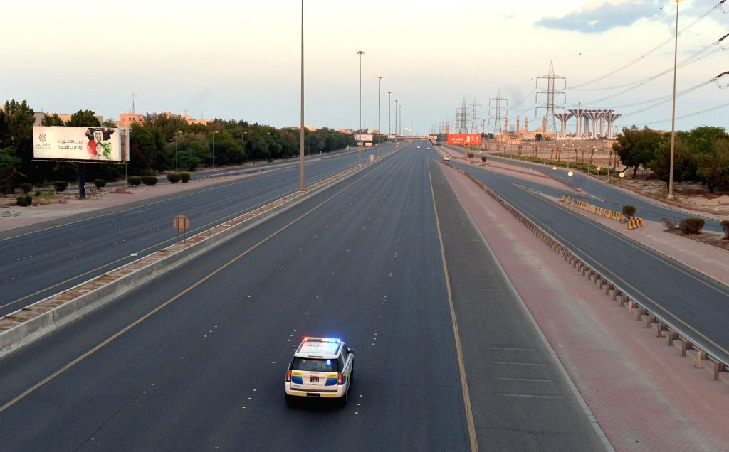 Photo taken on March 23, 2020 shows empty roads after the start of a curfew decreed by the government in Hawalli Governorate, Kuwait.   The Kuwaiti government has decided to impose a nationwide curfew to contain the spread of the coronavirus. (Photo