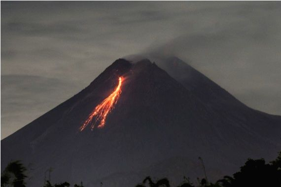 Photo taken on March 7, 2021 shows volcanic materials spewing from Mount Merapi as seen from Kaliurang, Yogyakarta, Indonesia.