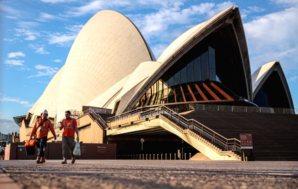 Photo taken on May 27, 2020 shows workers at Sydney Opera House in Sydney, Australia.   The COVID-19 outbreak in the Australian State of Victoria will likely delay ...