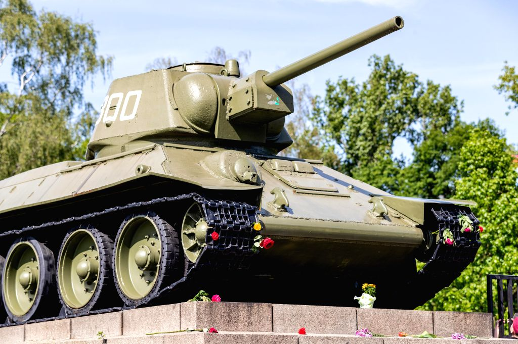 Photo taken on May 8, 2020 shows a Soviet tank with flowers at the Soviet War Memorial in the Tiergarten district in Berlin, capital of Germany. People gathered at ...