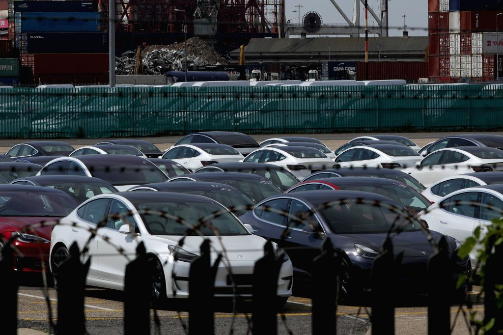 Photo taken on May 8, 2020 shows new vehicles for sale stored at Southampton Dock in Southampton, Britain. New car registration in Britain plunged by 97.3 percent ...