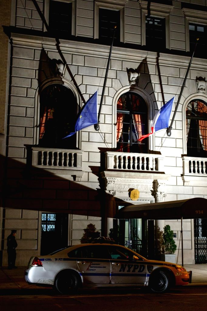 Photo taken on Nov. 13, 2015 shows lowered flags at the Consulate General of France on Fifth Avenue in New York. Over 100 people were killed in a mass ...