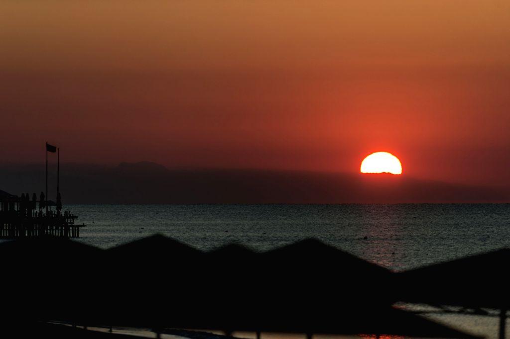 Photo taken on Nov. 13, 2015 shows the sun rises in Antalya, Mediterranean resort city of Turkey. The G20 summit will be held from Nov. 15 to 16 in Antalya. ...