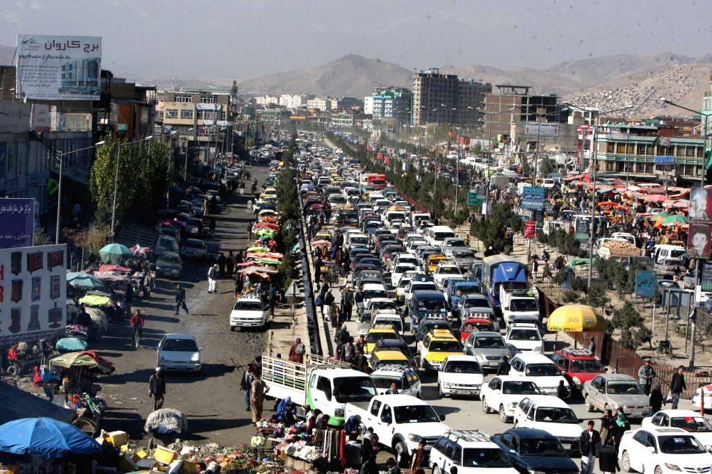 Photo taken on Nov. 16, 2015 shows Afghan commuters getting stuck in the traffic jam in Kabul, Afghanistan. Afghanistan's capital Kabul, a city with some 5 million ...