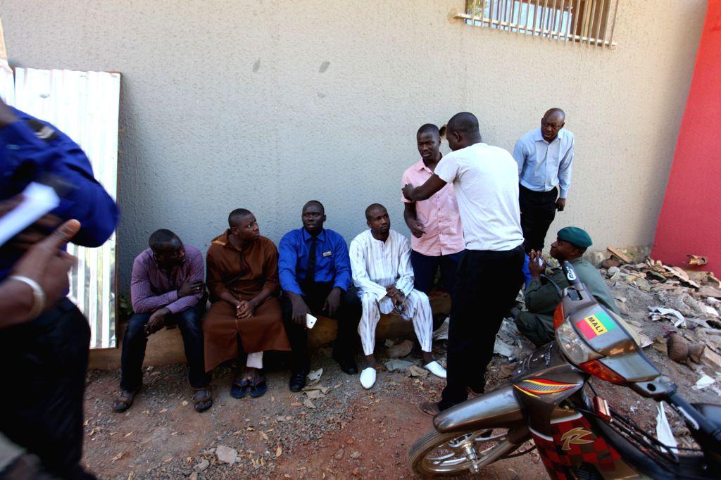 Photo taken on Nov. 20, 2015 shows freed hostages near Radisson Hotel in Bamako, Mali. At least 80 people taken hostage by unidentified gunmen in Radisson Hotel in ...
