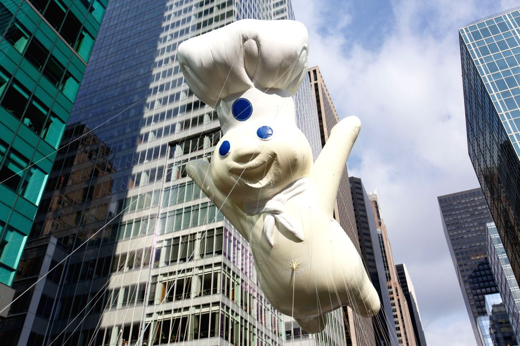 "Photo taken on Nov. 26, 2015 shows the balloon of ""Pillsbury Doughboy"" is seen during the 89th Macy's Thanksgiving Day Parade in New York, the United ..."
