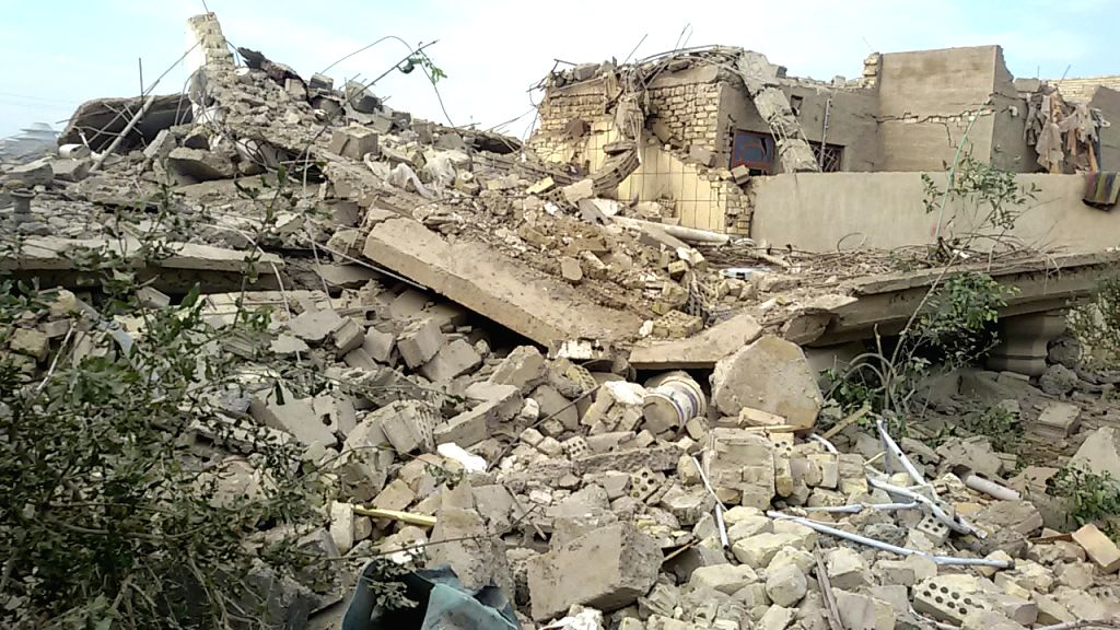 Photo taken on Nov. 27, 2015 shows destroyed buildings after an airstrike by the Iraqi Air Force in Islamic State (IS) militants-seized city of Fallujah, some 50 ...