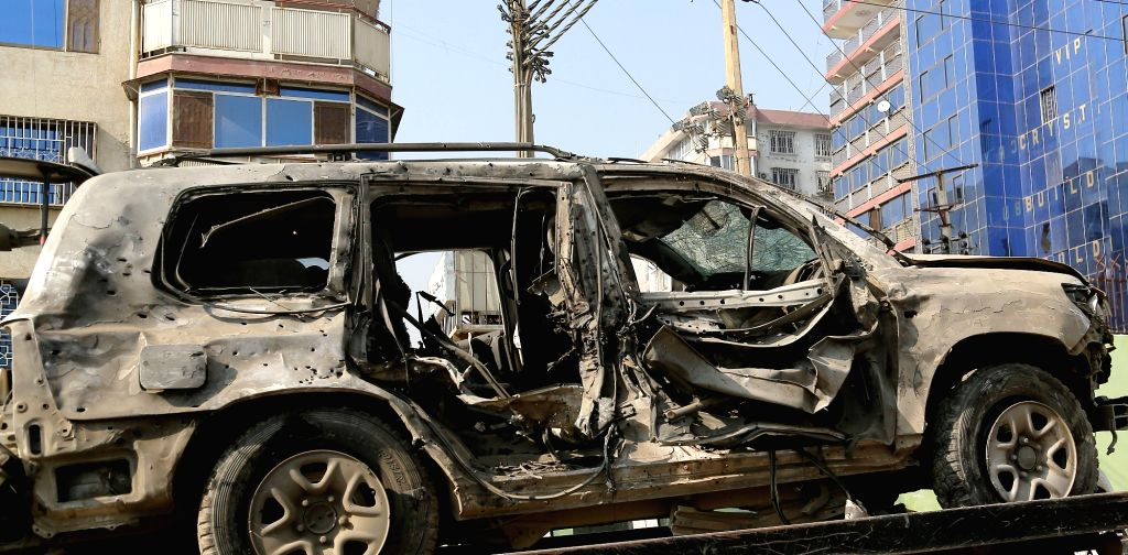 Photo taken on Nov. 28, 2015 shows a destroyed car at the site of a suicide attack in Kabul, capital of Afghanistan. Two persons including the attacker were killed ...