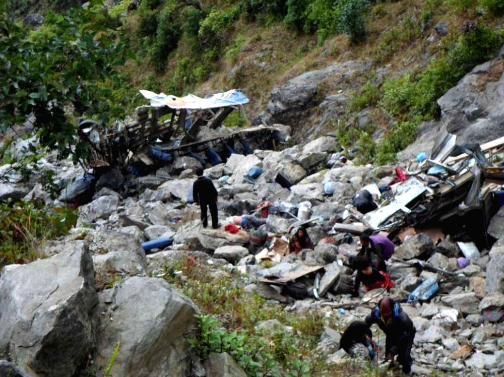 : Photo taken on Nov. 3, 2015 shows a bus accident site in which 30 people were killed at Ramche in Rasuwa, Nepal. The death toll in a road accident in northern ...