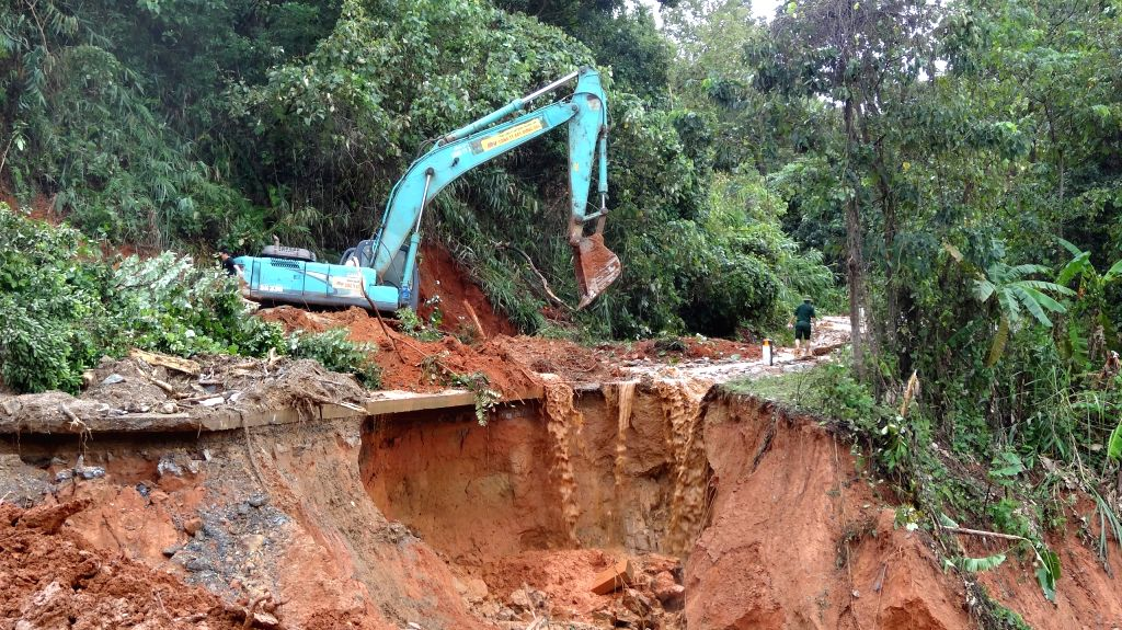 Photo taken on Oct. 18, 2020 shows an excavator in a landslide site in central Vietnam's Quang Tri Province. A landslide triggered by prolonged downpours has left ...