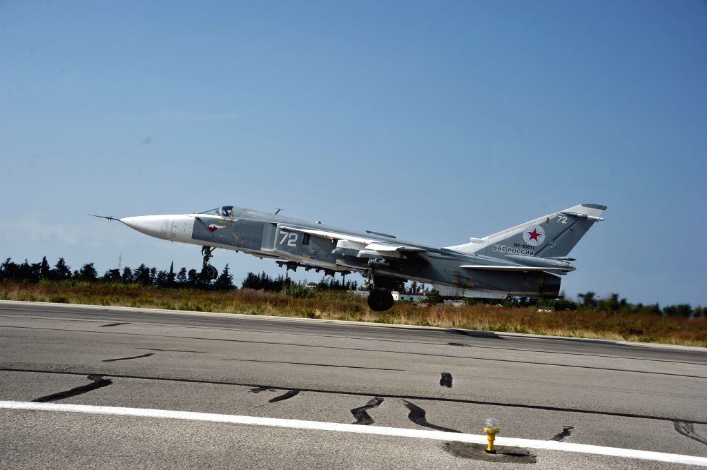 Photo taken on Oct. 21, 2015 shows Russian Sukhoi Su-24 taking off from the Hmeymim airbase in the Latakia province, Syria. The Russian Defense Ministry on Tuesday ...