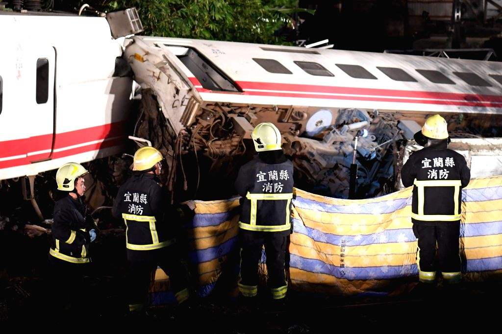 :Photo taken on Oct. 21, 2018 shows the rescuing site of the train derailment accident in Yilan County, southeast China's Taiwan. At least 17 people died and ...