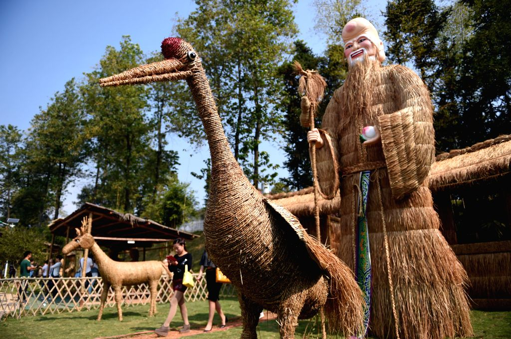 Photo taken on Oct. 23, 2015 shows straw installations created by local villagers in the fields of Gugang County Liuyang City, central China's Hunan Province. ...