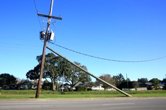 Photo taken on Oct. 29, 2020 shows a tilted utility pole in New Orleans, Louisiana, the United States.