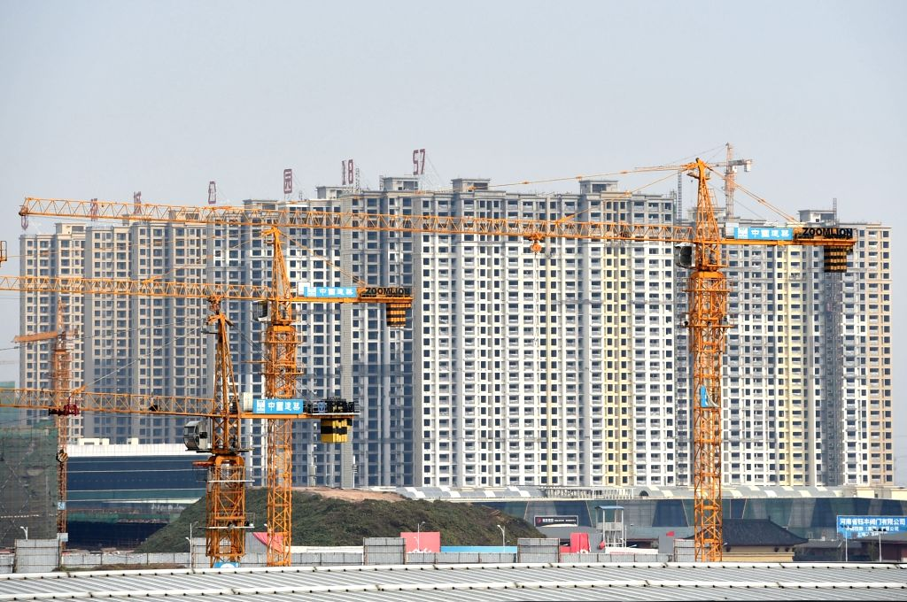 Photo taken on Oct. 30, 2015 shows residential buildings under construction in Zhengzhou, central China's Henan Province. China's economy grew by 6.9 percent in ...